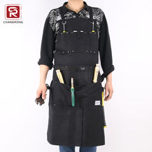 Black waxed canvas bib work apron for carpenter