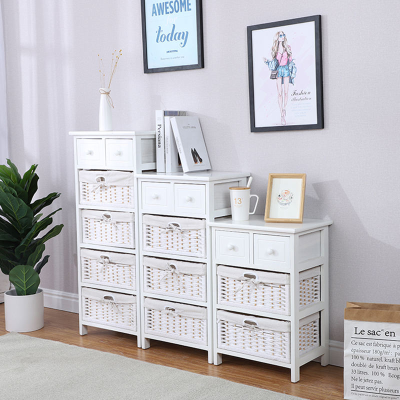 white wooden chest drawers with white woven baskets