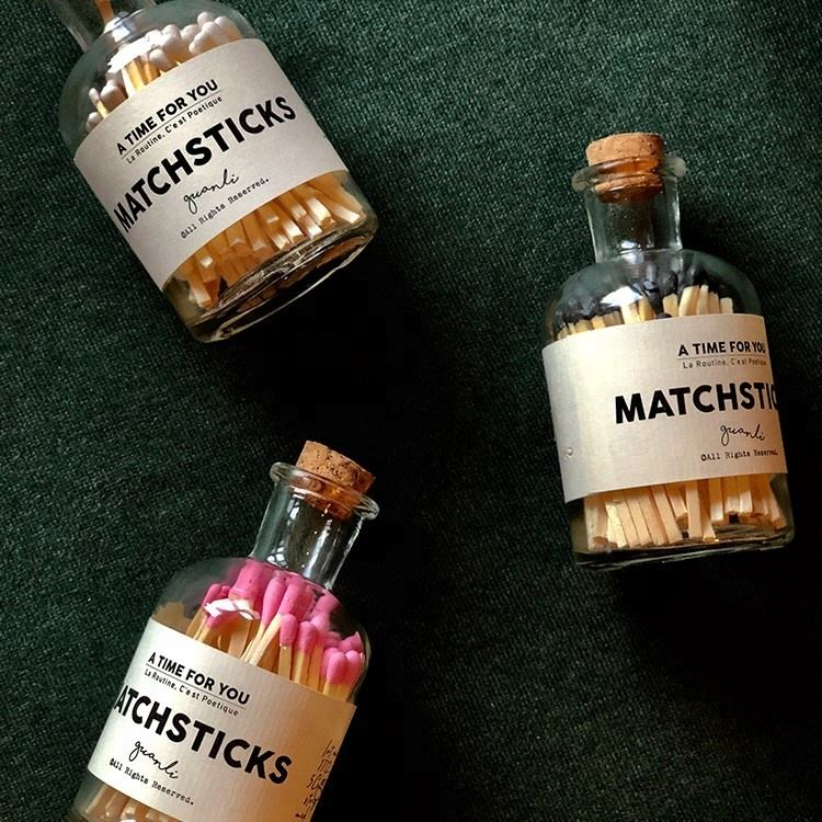 long wooden matches in bottle with label matches jar with match striker paper