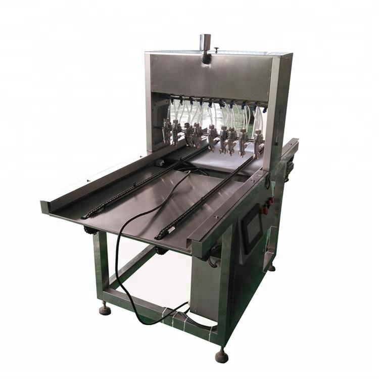 Automatic oil spray machine for baking tray