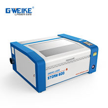 Jinan Gweike new design Mini small storm 600 laser engraving cutting machine price