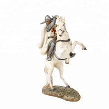 Lovely Resin figure depicting a knight on horseback riding into battle size is 10cms high