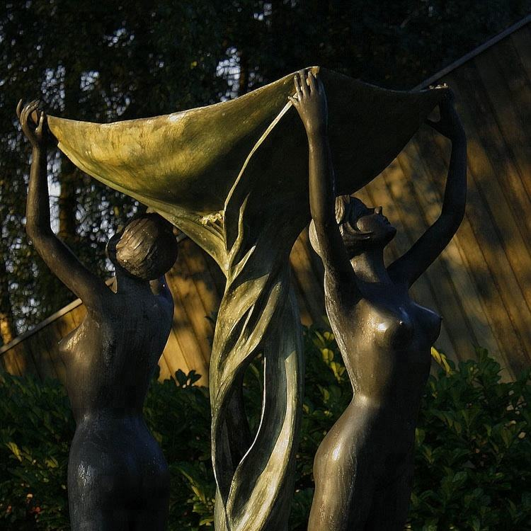 Bronze dancing girls in yard statue