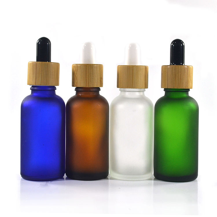 5ml 10ml 15ml 20ml 30ml 50ml 100ml frosted green blue amber clear essential oil glass dropper bottle with bamboo lid