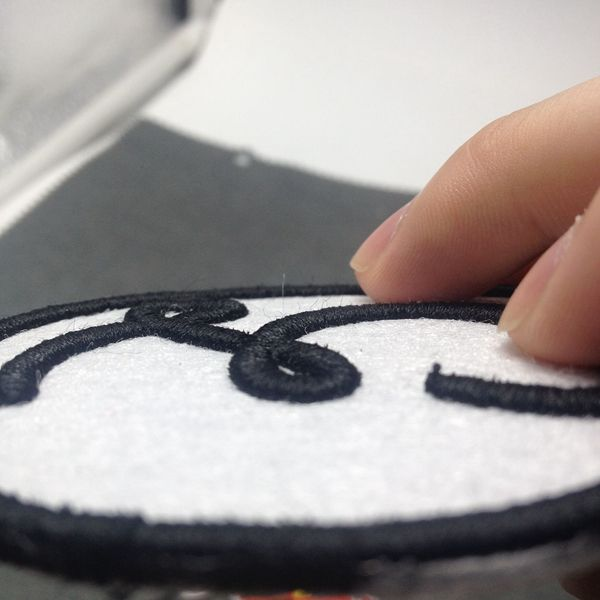 Custom 3D/puff embroidery patch heat cut border with heat seal on backing