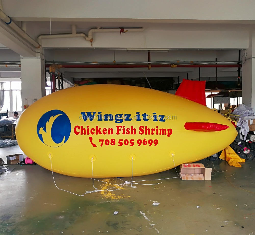inflatable airship balloon with yellow balloon logo advertising