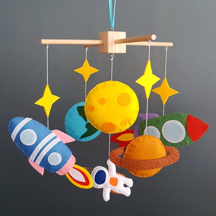 DIY felt hanging crib decoration with rocket and spaceman shape