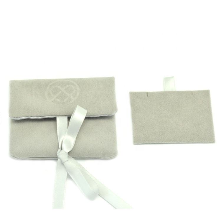 Microfiber suede jewelry button pouch with custom embossed logo