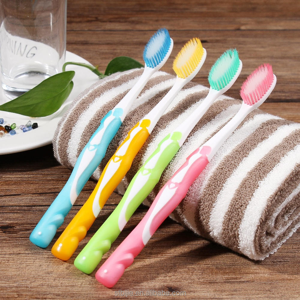 Deep cleaning feature soft bristle type and home use tooth brush