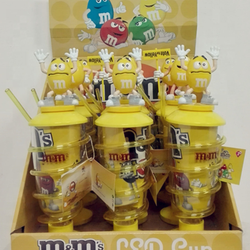 LED straw cup with candy and toys inside and M&M figure on lid