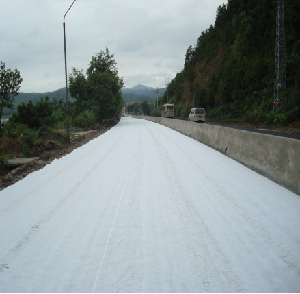 Nonwoven geotextile fabric for road construction