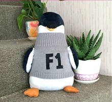 A penguin with sweater plush toy