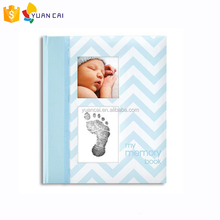 Baby Memory Book with an Included Clean-Touch Ink Pad to Create Baby's Hand print or Footprint blue