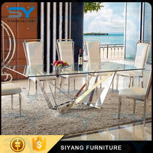 Fashion 6 chair seaters stainless steel fiber dining table set with glass CT017