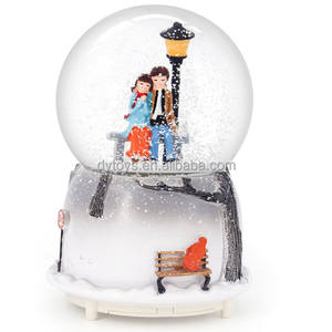 Sweetheart couple snow globe