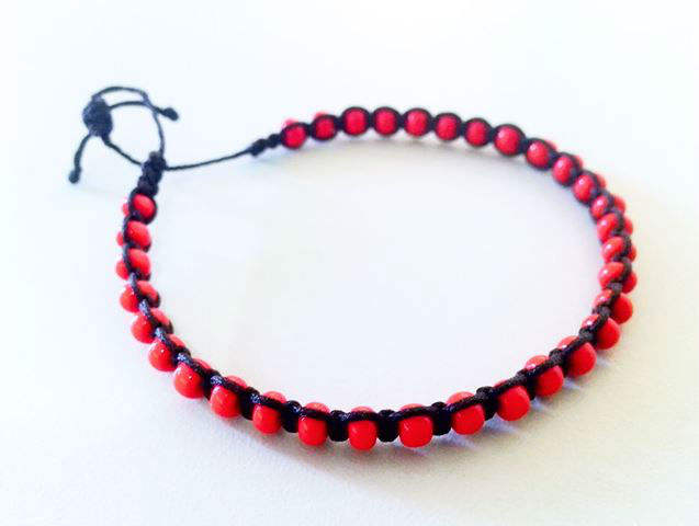 Craft bracelet on waxed cord with applique