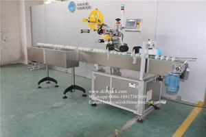 Auto top side egg carton labeling machine