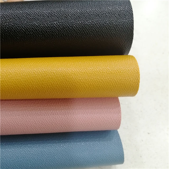 Cheap artificial pvc leather stock lot spunlace nonwoven backing litchi Saffiano pebble surface effects pvc leather for handbag