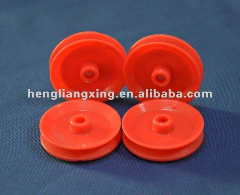 Red plastic pulley wheel for toys