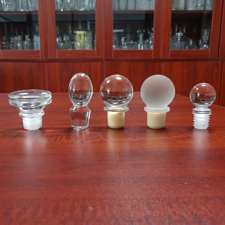 Ball shape glass cap with synthetic spirit stoppers for glass bottles