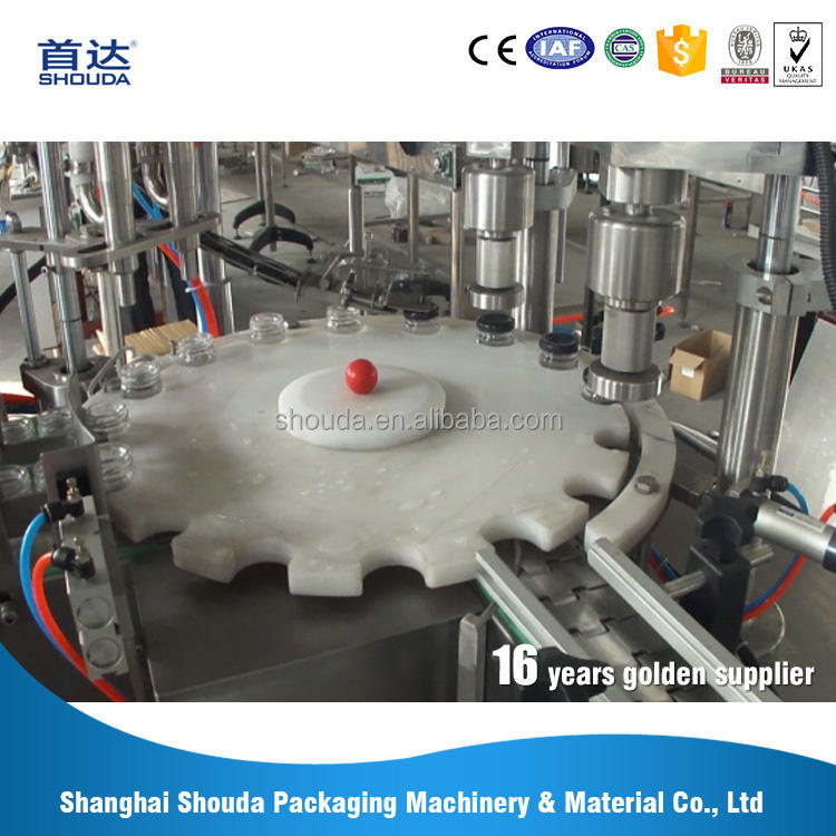 Washing filling and capping machine applied to various material flat bottles