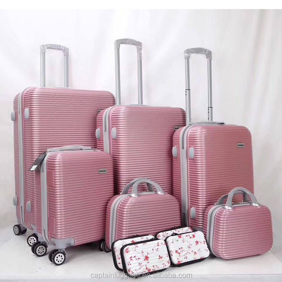 Dongguan factory wholesale ABS 6pcs travel luggage set and 4 make-up bags for women