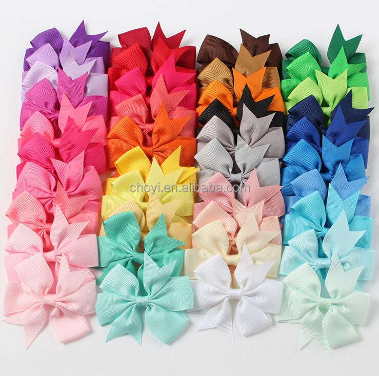 Solid color ribbon fishtail bowknot stock hair bow satin custom logo ribbon bowknot design