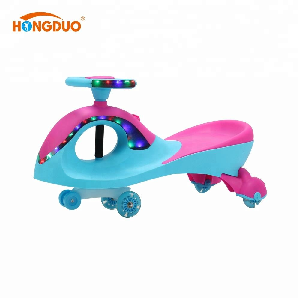 Cheap Plastic toy baby swing ride on car with music and light