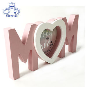wooden love word with photo frame