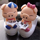 Pretty cute pig couples sit on toilet solar powered toy/creative gift japanese solar toy/make your solar toy manufacturer