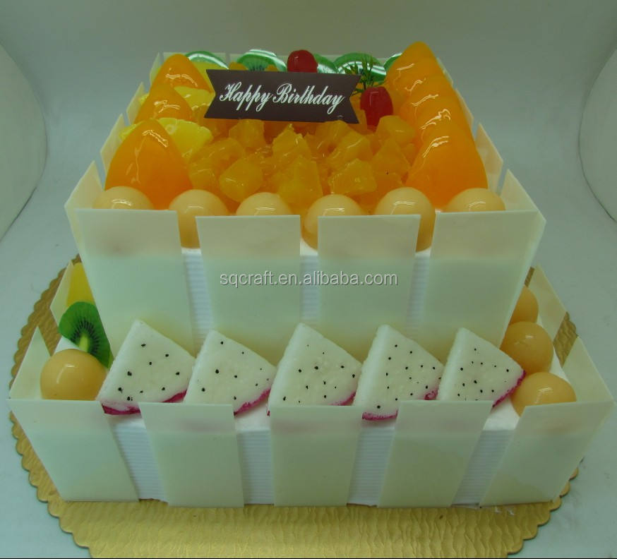 Artificial wedding/anniversary/birthday cake with fake fruits decoration
