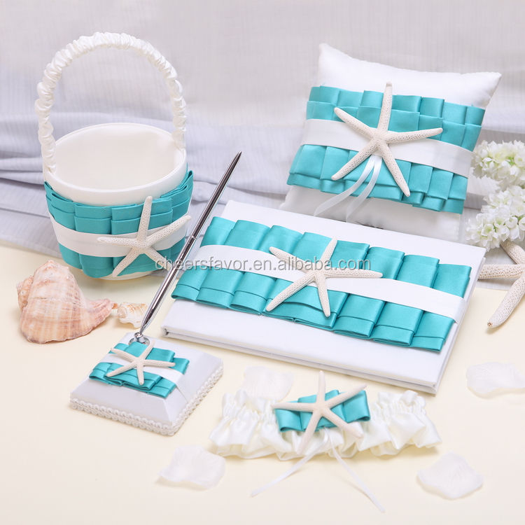 Bianco e turchese stelle marine wedding guest book pen set anello cuscino flower basket giarrettiera