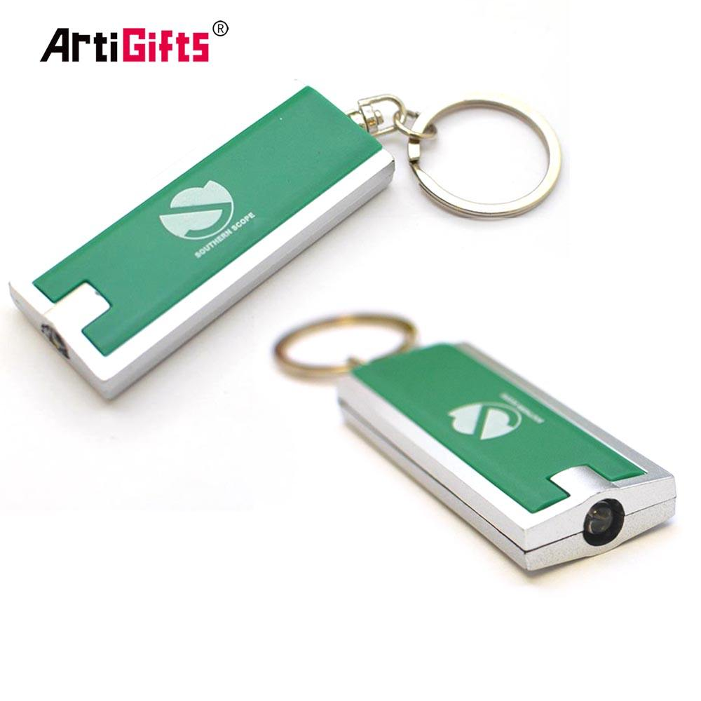 Wholesale cheap metal and plastic keychain with led light