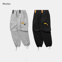 2018 wholesale new fashion casual windbreak material ribbon pockets track mens pants