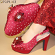 red color nigerian wedding shoes and matching bag set teal shoes and bag to match latest design Nigerian shoes and bag for women