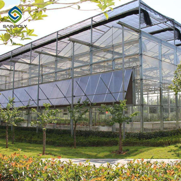 Greenhouses For Agriculture The Cheapest Hot Sale Sainpoly Large Agriculture Forever Flowering Glass Greenhouse For Sale