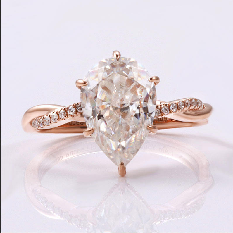 Stunning 14k rose gold twist engagement ring with pear crushed ice cut moissanite and hidden lab diamond halo