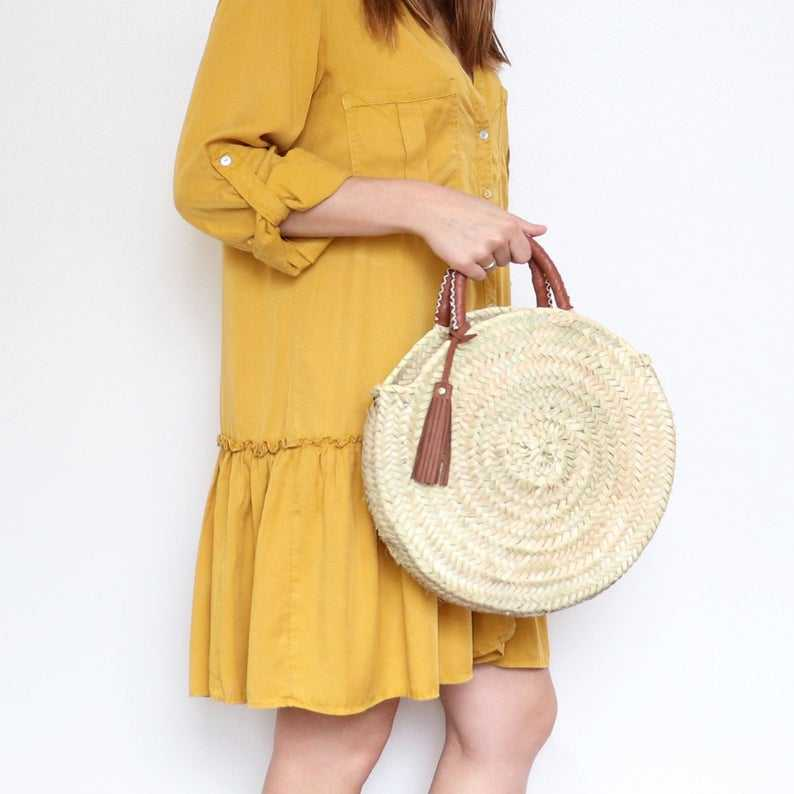 Round Straw Bag with Leather Stitched Handles and Tassel