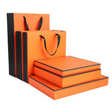 OEM Factory Orange color printing gift box and paper bag together with flat handles