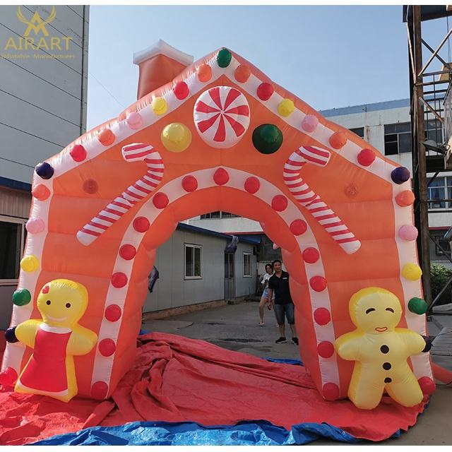 outdoor blow up christmas decor Gingerbread man bear candy adorns inflatable Christmas arch