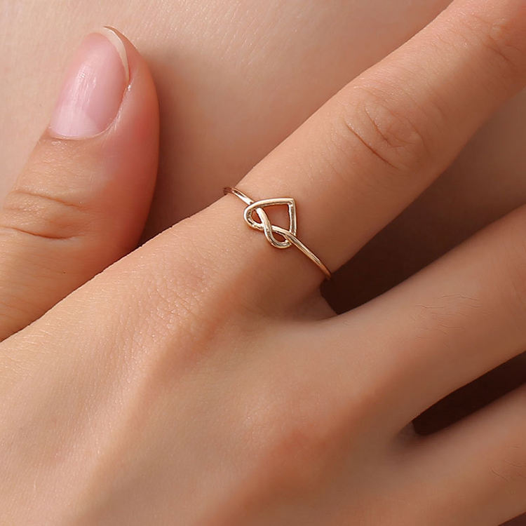 Korean knot opening ring female Japanese and Korean temperament simple new hollow heart love ring