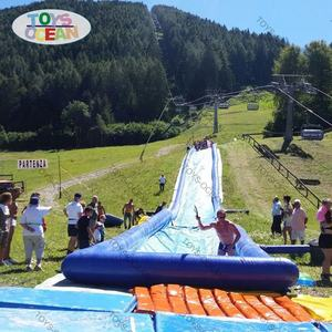 inflatable water slide on the mountain
