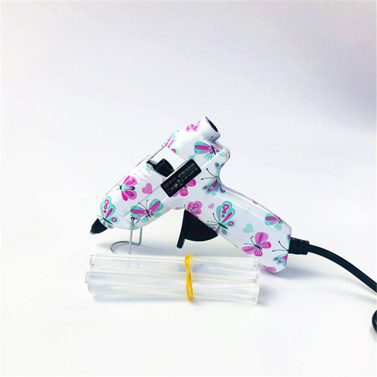 Butterfly pattern shell with Black trigger with 10pcs Transparent glue sticks Hot glue gun with glue stick