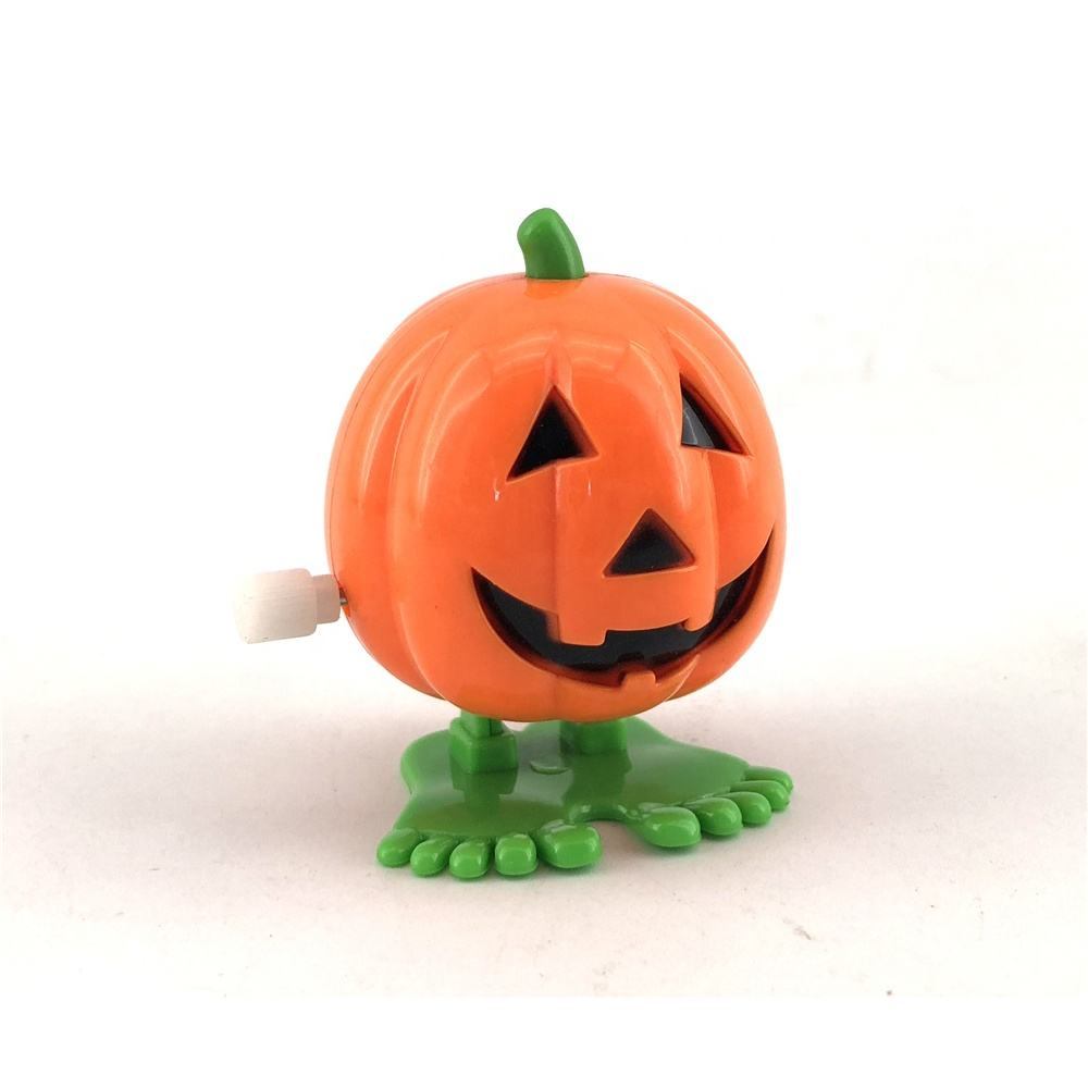 Wholesale cheap kid's funny mini plastic cartoon pumpkin witch wind up toys halloween christmas gift