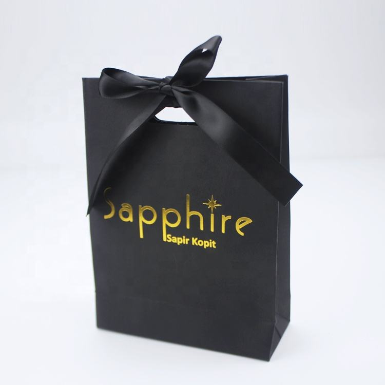 HIgh End Custom Gold Hot Foil Logo Die Cut Handle Black Paper Gift Bag With Ribbon Bow