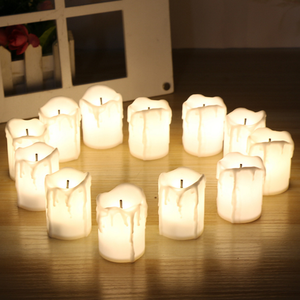 Battery powered drip LED candle with optical fiber wick