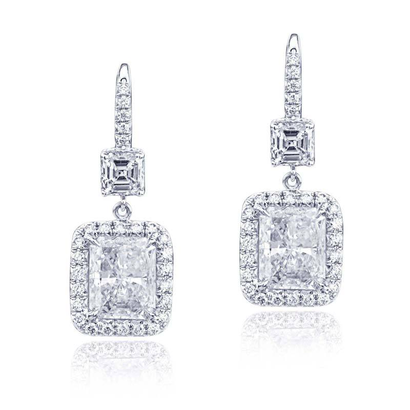 Magnificent diamond drop earrings radiant cut diamonds edged in micro pave and hung by silver jewelry