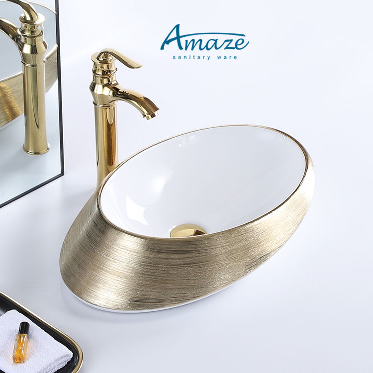 Hotel home decor chaozhou fancy luxury oval plated gold and white ceramic table top bathroom vessel sink art hand wash basin