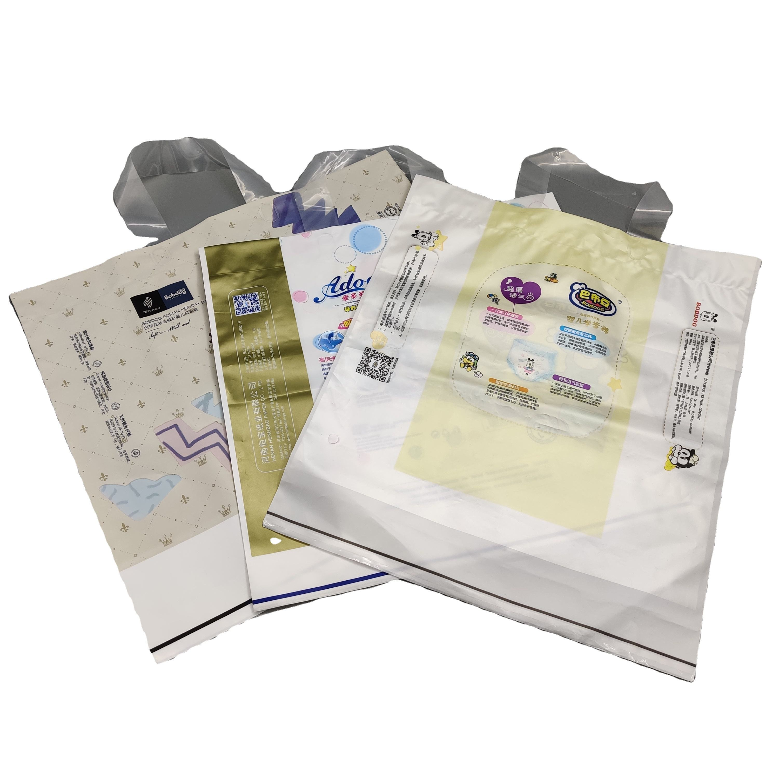 Custom printed baby diaper XGPE/BPE medical materials plastic packaging bag with a handle