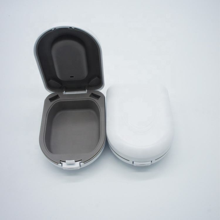 Hot sale digital hearing aid round plastic case for packing bte hearing aids,phonak hearing aid